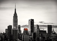 Black and white version of the New York City skyline with Empire State Building and The New Yorker, two landmarks of the city.